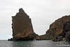 Pinnacle rock formation with zodiac at Bartolome Island~Galapagos, Ecuador