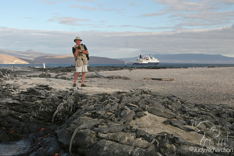 Alan with Celebrity Xpedition and a pile of Marine Iguanas on Espinoza Island~Galapagos