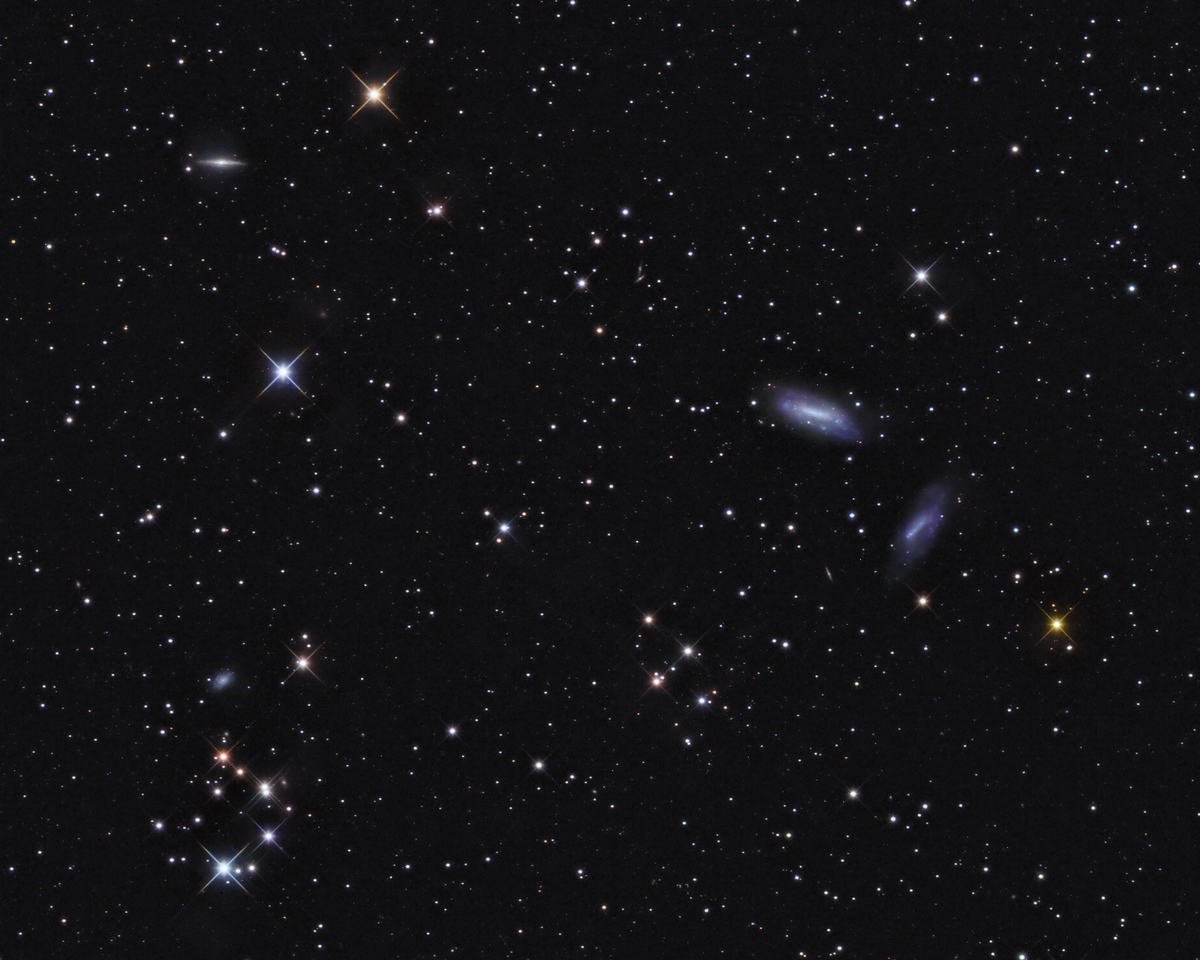 Collinder 21 & adjacent galaxies  --  in Triangulum   Location: Gibsonia, PA   Equipment: Imaging Camera = ATIK 383L Camera  Autoguiding Camera = Atik16IC via an OAG Telescope OTA = Tele Vue NP127is @f5.2 Mount = CGEM Home made cross filter  Exposures = multiple 5 min. L and multiple 10 min. each RGB  Software = Maxim DL and Straton and Photoshop CS5