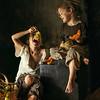 Garçon et jeune fille mangeant Raisins et Melon