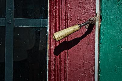 Poignée de porte en bois.