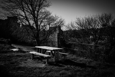 Pic-nic table and trees near fortress of Baux de Provence, France
