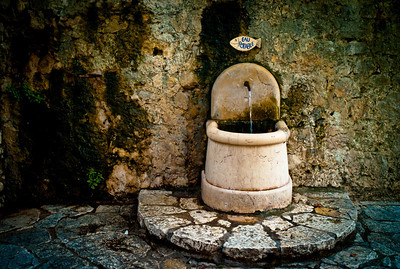 Old fountain in Saint-Paul, France, French Riviera.