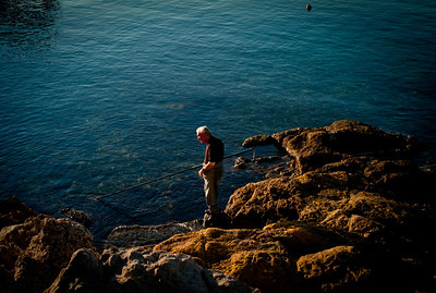 Old man fishing in Cap d'Antibes