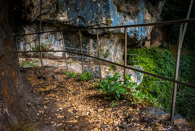 Abandoned path near waterfalls in Saut-du-Loup, France