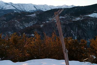 Old wood pole on the road to Valberg, France