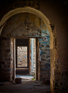 Looking through doors in abandoned building in Camp des Fourches on Col de la Bonnette on the Maginot line, Vallée de la Queyras, Hautes-Alpes in France