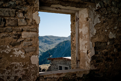 Looking by the window in abandoned building in Camp des Fourches on Col de la Bonnette on the Maginot line, Vallée de la Queyras, Hautes-Alpes in France