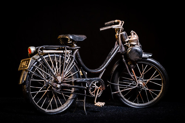Studio shot of a an old motorized bicycle