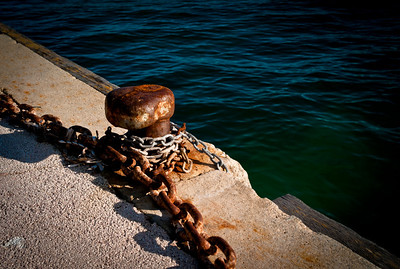 Chain and dock in Port du Niel on Presqu'île de Giens, French Riviera, France
