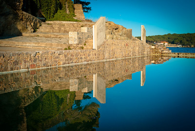 Wall reflection in bassin near Port du Niel on Presqu'île de Giens, French Riviera, France