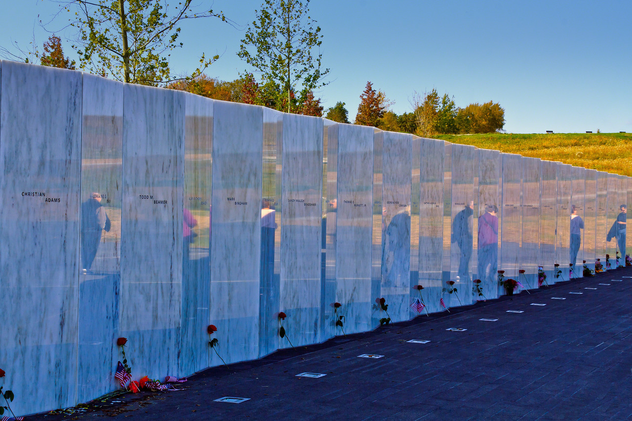 Wall Honoring the Deceased Passengers of Flight 93 which is reflective marble with the name passenger engraved separately on their own panel.