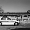 A taxi driver sleep to wait customer in his cab front of destroyed Tomioka station by Tsunami. Tomioka town Futaba, Fukushima 9th Mar 2014