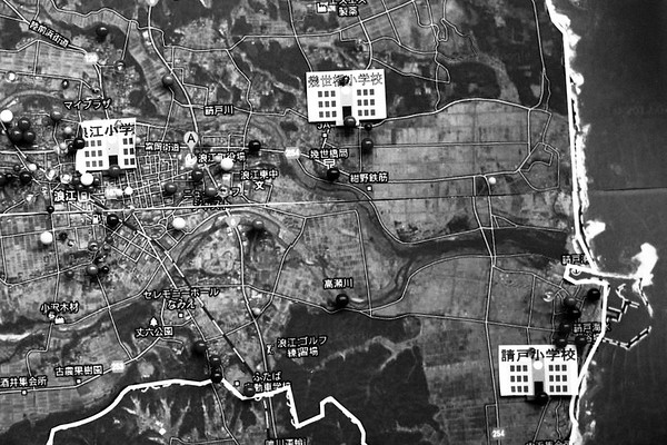 Inhabitants pointed to the pin by a festival of Namie-machi in the place where there were their houses on a map. Fukushima 24th Nov 2012
