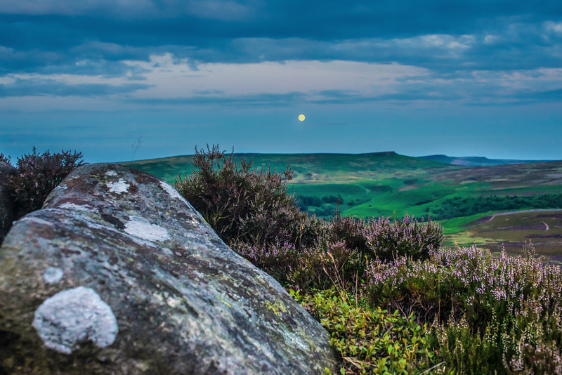 The blue moon over derwent edge in peak district.