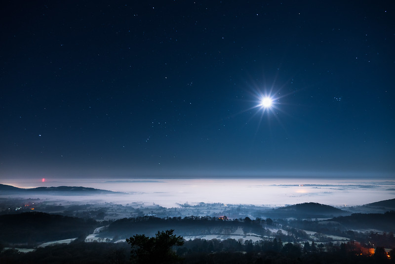 Misty Moonlit night over Malvern HIlls