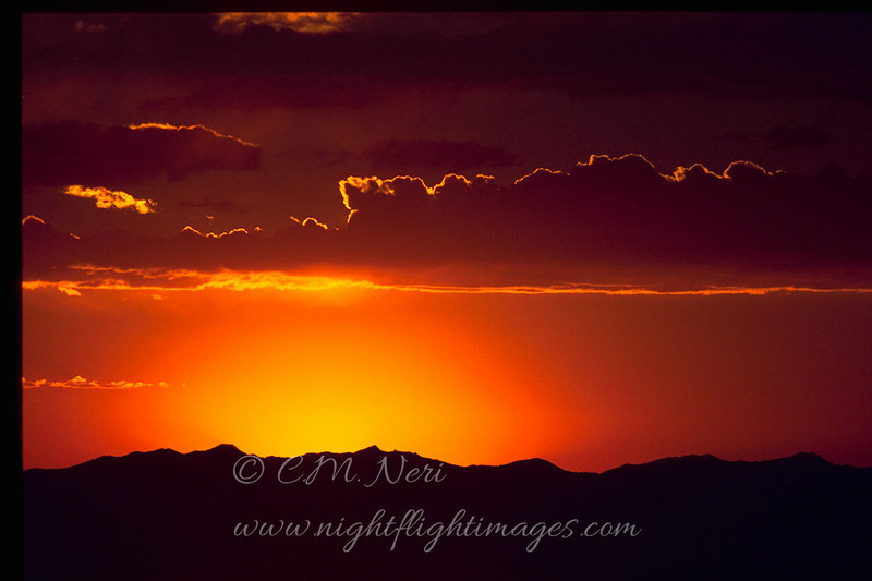 "Sunset © 2000 C. M. Neri Goshute Mountains, NV SUNSETNV  <div class=""ss-paypal-button""><div class=""ss-paypal-add-to-cart-section""><div class=""ss-paypal-product-options""><h4>Mat Sizes</h4><ul><li><a href=""https://www.paypal.com/cgi-bin/webscr?cmd=_cart&amp;business=T77V5VKCW4K2U&amp;lc=US&amp;item_name=Sunset%20%C2%A9%202000%20C.%20M.%20Neri%20Goshute%20Mountains%2C%20NV%20SUNSETNV&amp;item_number=http%3A%2F%2Fwww.nightflightimages.com%2FGalleries-1%2FTravels%2Fi-J4NV7L5&amp;button_subtype=products&amp;no_note=0&amp;cn=Add%20special%20instructions%20to%20the%20seller%3A&amp;no_shipping=2&amp;currency_code=USD&amp;weight_unit=lbs&amp;add=1&amp;bn=PP-ShopCartBF%3Abtn_cart_SM.gif%3ANonHosted&amp;on0=Mat%20Sizes&amp;option_select0=5%20x%207&amp;option_amount0=10.00&amp;option_select1=8%20x%2010&amp;option_amount1=18.00&amp;option_select2=11%20x%2014&amp;option_amount2=28.00&amp;option_select3=card&amp;option_amount3=4.00&amp;option_index=0&amp;charset=utf-8&amp;submit=&amp;os0=5%20x%207"" target=""paypal""><span>5 x 7 $11.00 USD</span><img src=""https://www.paypalobjects.com/en_US/i/btn/btn_cart_SM.gif""></a></li><li><a href=""https://www.paypal.com/cgi-bin/webscr?cmd=_cart&amp;business=T77V5VKCW4K2U&amp;lc=US&amp;item_name=Sunset%20%C2%A9%202000%20C.%20M.%20Neri%20Goshute%20Mountains%2C%20NV%20SUNSETNV&amp;item_number=http%3A%2F%2Fwww.nightflightimages.com%2FGalleries-1%2FTravels%2Fi-J4NV7L5&amp;button_subtype=products&amp;no_note=0&amp;cn=Add%20special%20instructions%20to%20the%20seller%3A&amp;no_shipping=2&amp;currency_code=USD&amp;weight_unit=lbs&amp;add=1&amp;bn=PP-ShopCartBF%3Abtn_cart_SM.gif%3ANonHosted&amp;on0=Mat%20Sizes&amp;option_select0=5%20x%207&amp;option_amount0=10.00&amp;option_select1=8%20x%2010&amp;option_amount1=18.00&amp;option_select2=11%20x%2014&amp;option_amount2=28.00&amp;option_select3=card&amp;option_amount3=4.00&amp;option_index=0&amp;charset=utf-8&amp;submit=&amp;os0=8%20x%2010"" target=""paypal""><span>8 x 10 $19.00 USD</span><img src=""https://www.paypalobjects.com/en_US/i/btn/btn_cart_SM.gif""></a></li><li><a href=""https://www.paypal.com/cgi-bin/webscr?cmd=_cart&amp;business=T77V5VKCW4K2U&amp;lc=US&amp;item_name=Sunset%20%C2%A9%202000%20C.%20M.%20Neri%20Goshute%20Mountains%2C%20NV%20SUNSETNV&amp;item_number=http%3A%2F%2Fwww.nightflightimages.com%2FGalleries-1%2FTravels%2Fi-J4NV7L5&amp;button_subtype=products&amp;no_note=0&amp;cn=Add%20special%20instructions%20to%20the%20seller%3A&amp;no_shipping=2&amp;currency_code=USD&amp;weight_unit=lbs&amp;add=1&amp;bn=PP-ShopCartBF%3Abtn_cart_SM.gif%3ANonHosted&amp;on0=Mat%20Sizes&amp;option_select0=5%20x%207&amp;option_amount0=10.00&amp;option_select1=8%20x%2010&amp;option_amount1=18.00&amp;option_select2=11%20x%2014&amp;option_amount2=28.00&amp;option_select3=card&amp;option_amount3=4.00&amp;option_index=0&amp;charset=utf-8&amp;submit=&amp;os0=11%20x%2014"" target=""paypal""><span>11 x 14 $29.00 USD</span><img src=""https://www.paypalobjects.com/en_US/i/btn/btn_cart_SM.gif""></a></li><li><a href=""https://www.paypal.com/cgi-bin/webscr?cmd=_cart&amp;business=T77V5VKCW4K2U&amp;lc=US&amp;item_name=Sunset%20%C2%A9%202000%20C.%20M.%20Neri%20Goshute%20Mountains%2C%20NV%20SUNSETNV&amp;item_number=http%3A%2F%2Fwww.nightflightimages.com%2FGalleries-1%2FTravels%2Fi-J4NV7L5&amp;button_subtype=products&amp;no_note=0&amp;cn=Add%20special%20instructions%20to%20the%20seller%3A&amp;no_shipping=2&amp;currency_code=USD&amp;weight_unit=lbs&amp;add=1&amp;bn=PP-ShopCartBF%3Abtn_cart_SM.gif%3ANonHosted&amp;on0=Mat%20Sizes&amp;option_select0=5%20x%207&amp;option_amount0=10.00&amp;option_select1=8%20x%2010&amp;option_amount1=18.00&amp;option_select2=11%20x%2014&amp;option_amount2=28.00&amp;option_select3=card&amp;option_amount3=4.00&amp;option_index=0&amp;charset=utf-8&amp;submit=&amp;os0=card"" target=""paypal""><span>card $5.00 USD</span><img src=""https://www.paypalobjects.com/en_US/i/btn/btn_cart_SM.gif""></a></li></ul></div></div> <div class=""ss-paypal-view-cart-section""><a href=""https://www.paypal.com/cgi-bin/webscr?cmd=_cart&amp;business=T77V5VKCW4K2U&amp;display=1&amp;item_name=Sunset%20%C2%A9%202000%20C.%20M.%20Neri%20Goshute%20Mountains%2C%20NV%20SUNSETNV&amp;item_number=http%3A%2F%2Fwww.nightflightimages.com%2FGalleries-1%2FTravels%2Fi-J4NV7L5&amp;charset=utf-8&amp;submit="" target=""paypal"" class=""ss-paypal-submit-button""><img src=""https://www.paypalobjects.com/en_US/i/btn/btn_viewcart_LG.gif""></a></div></div><div class=""ss-paypal-button-end""></div>"