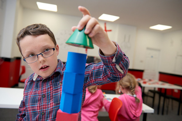 Photo by Ryan Cowan - Oxford Mathsnasium Opening Day. Mathsnasium fan Ben Tate has a little fun making a tower during the open day while his little sisters Florence and Jemimah enjoy the free sweets. (Contact mother  Ruth Tate - ruth.tate@lmh-oxford.com)