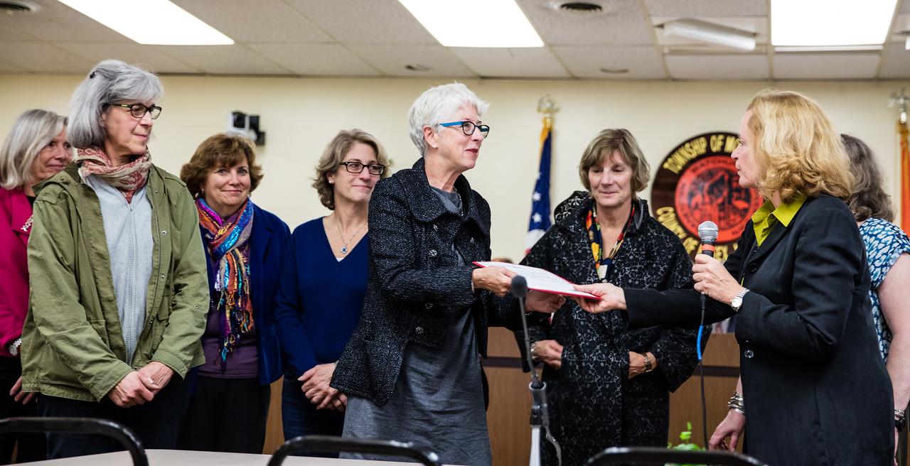 Garden Club of Montclair President Deborah Hirsch accepts the Montclair Preservation Service Award from the Montclair Historic Preservation Commission.