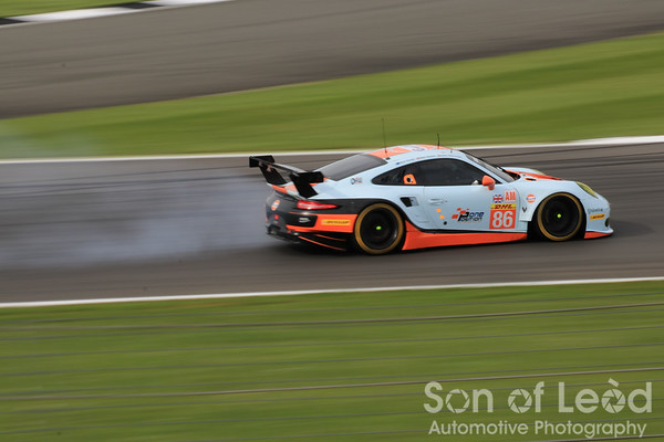 The Gulf Racing Porsche locks up into thru Vale
