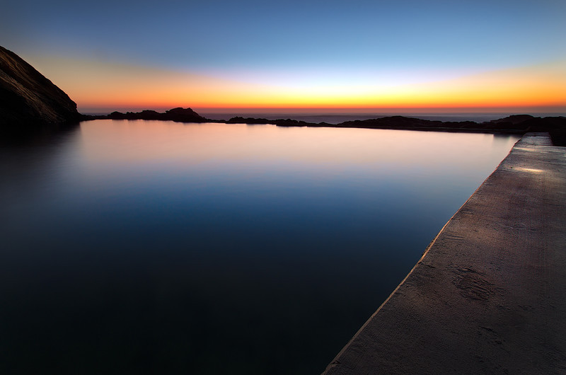 Dawn Across the Blue Pool. Bermagui NSW South Coast
