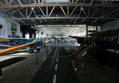 The historic old hanger that houses the indoor part of the collection. Interesting, but not near as much fun for a photographer because most of the hanger contained traditional airplane exhibits.   Oakland Aviation Museum Oakland International Airport  September 17. 2009