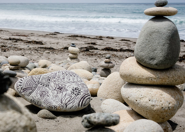 Traditional rock stacks with a twist.  Someone gave this smooth rock a fabulous tattoo!