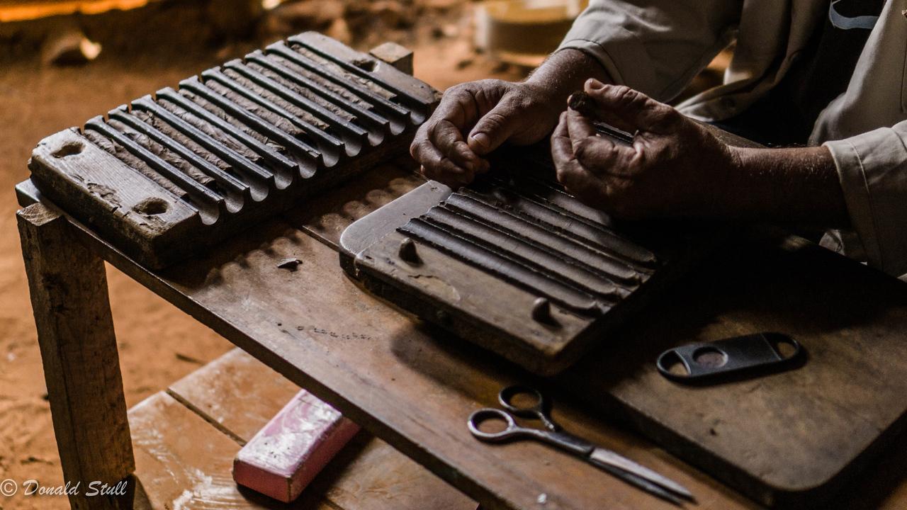 Making a cigar, Concha and Paco Hernandez family farm, Viñales Valley, Cuba