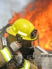 A Chattanooga recruit firefighter prepares for battle at a training burn that marks his class' graduation from the academy.
