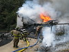 Fort Oglethorpe and Catoosa County, GA firefighters were kept busy for several hours in the hot summer sun fighting a garage fire on Mason Drive.