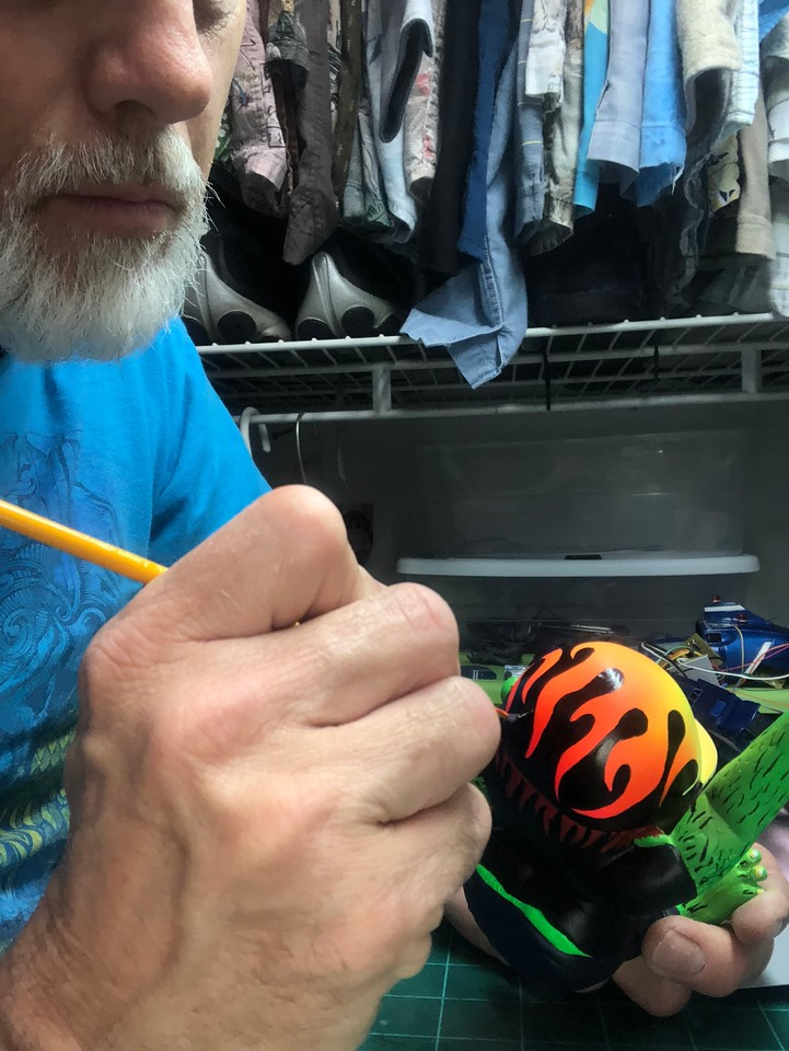 HAND PAINTING THE PINSTRIPE LINES ON THE HELMET