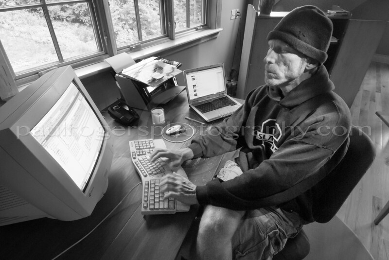 Rusty works on his computer in his home office, Elmore