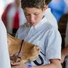 A boy prepares his cow for competition at the Tunbridge World's Fair, Tunbridge, VT.
