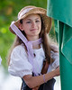 Girl dressed in period clothing prepares to participate in a Labor Day Parade, Northfield, VT.