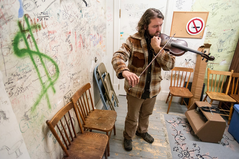 Patrick Ross Tuning His Fiddle, Derby Line, 2014