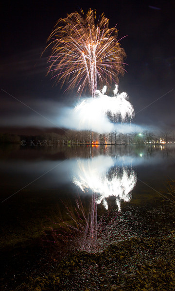 Belmont Lake State Park 12/3/11 Annual Tree Lighting Ceremony Further into the show...smoke building, lack of wind adds dramatic reflections off of he Lake.