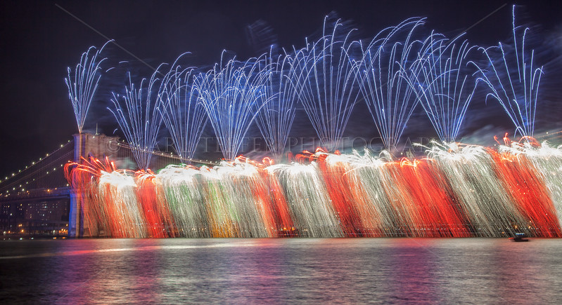 """July 4, 2014: Unique """"Waterfall"""" effect directly from the Brooklyn Bridge, produced by Pyro Spectacular"""