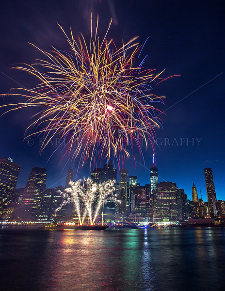 July 4, 2014: East River Barge launching blasts over Lower Manhattan