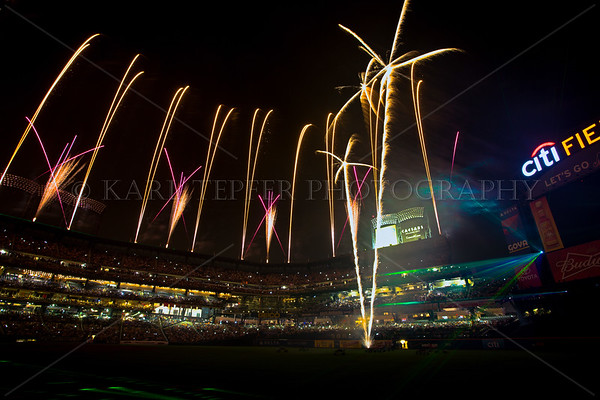Fireworks Pyro night at CitiField, New York City, July 3, 2013. I was able to obtain permission to photograph from directly on the field! Was basically the only person on the entire field, except for the pyro-technicians standing at the exit. New feature: Laser Light Show...seen on right side of image.