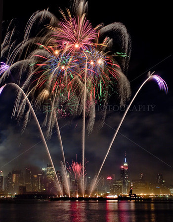 July 4, 2010...Fireworks over the Hudson River.  Show produced by Pyro Spectacular fireworks company