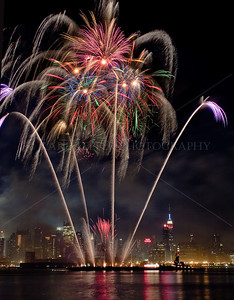 July 4th, 2010.  Macy's spectacular fireworks  and Manhattan as viewed from the New Jersey Side.  Empire State Building on right hand side.