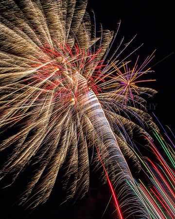 """Huge, colorful, blast quite close and extremely exciting! The white """"horsehair"""" pattern, produced as shells head towards sky, was a dominant theme during the program. This blast, as with many others, was too broad to fit within my wide angle lens."""