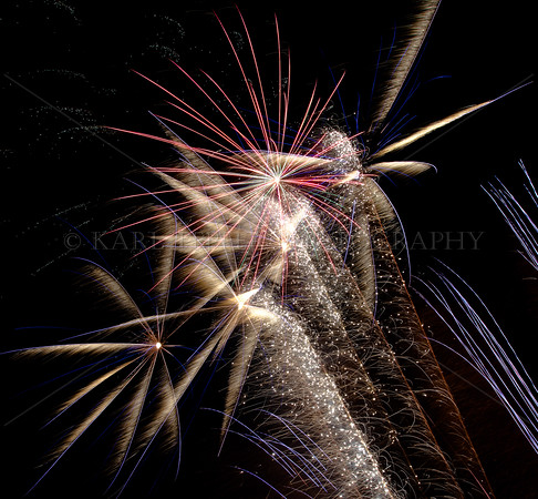 Multitude of sparks, trailing embers, and quite loud! Visual, auditory, and sensual cacophony