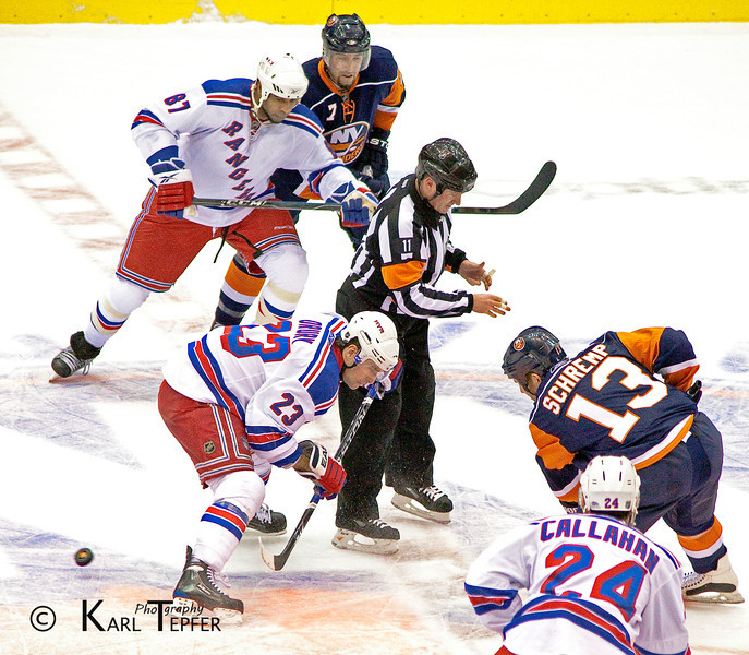 No one seemed to notice the puck right after this face off.<br /> New York Rangers vs. Islanders.  December 18th 2009. <br /> Rangers won, 5-3