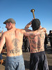 Coney Island Polar Bear Club Swim: New Year's Day 2009. <br /> Everton Football Club is a soccer team from Liverpool, England.  The logo on the trumpet player's back is the team symbol and date of formation, 1878.