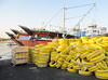 <h2>Yellow tires waiting to be loaded for shipment to India