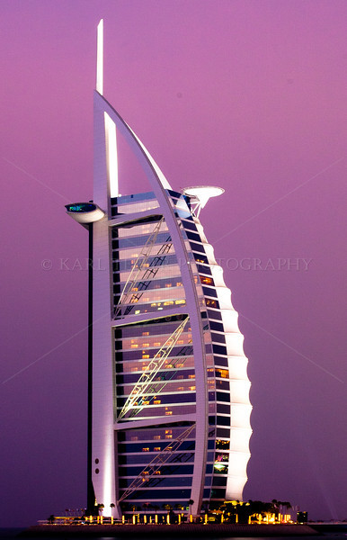 <h2>Close up of the Burj al Arab. The heliport (and occasional tennis court) can be seen in the upper right portion towards the top of the hotel.