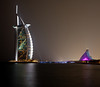 <h2>Burj al Arab and the Jumeirah Beach Hotels. To be able to get to the location in order to capture this shot, I had to walk out on a long pier that lead to an exclusive restaurant.  Luckily, I arrived early, engaged in conversation with the staff, and they allowed me to stay. What they didn't mention was that there would be frequent golf carts zooming right by me at about 35 mph as they drove guests from the nearby hotels to the restaurant.  It was a very narrow pier, and I had to cling to the railing of the fence as they zoomed by.  The carts also did not turn around but rather backed up the length of the pier at the same speed. I was not overly concerned about getting hit, but was disturbed since every time the carts drove by the vibrations would ruin the extended time exposure necessary to achieve these shots.