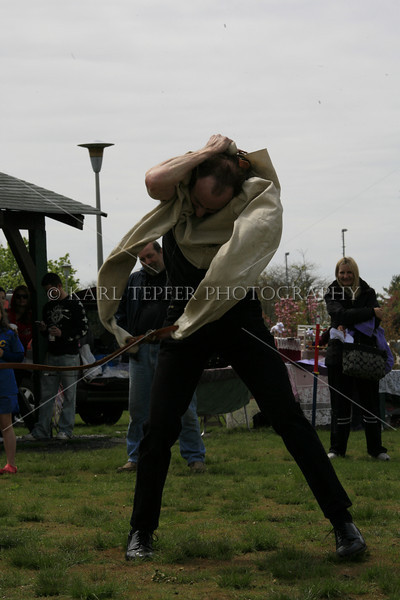 Neil Alexander, Magician performing at Beltane 2009.  He escaped from a straight jacket wrapped in chains, ate fire, and was quite entertaining.