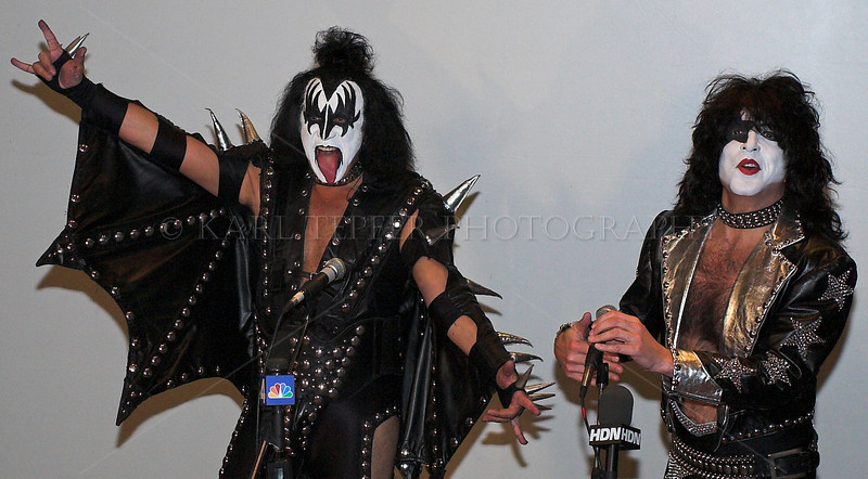 """<h2>So I show up for my official parade Press Pass, and they tell me the press conference is about to start.  I go into this small auditorium, and about a minute later in walk the """"Grand Marshals"""" of the 2006 NYC Parade: Gene Simmons and Paul Stanley of the rock group KISS.  Actually I was never big fans of the group, but being about ten feet from them while they were doing their posing, it was a great opportunity to get some great shots.  They also had the """"Kiss Girls"""" with them who were kind enough to pose for me after the press conference.  They had an exciting float in the parade, with their music blasting, the girls dancing and shooting confetti into the sky.  The crowd went nuts and I was able to get some action shots. New York City Halloween Parade, 2006."""